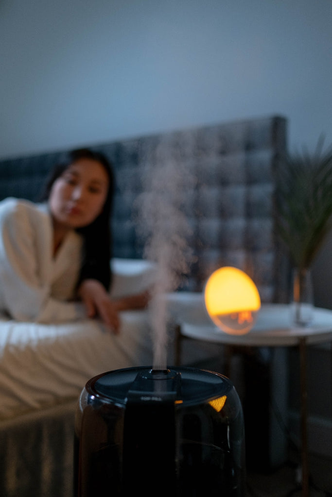 woman sleeping with humidifier beside her