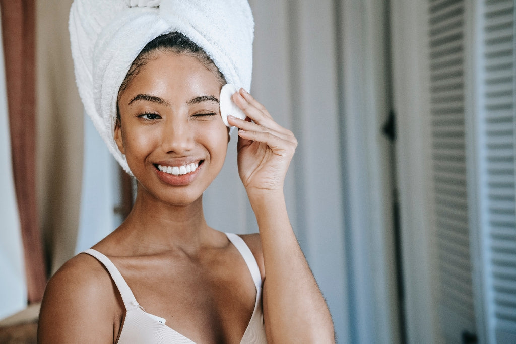woman applying skincare product to her face