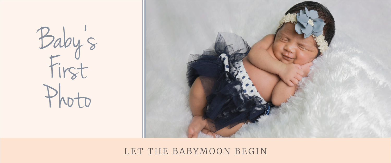 """Image of newborn baby in black tutu on a furry blanket with text reading """"Baby's First Photo"""" and """"Let the Babymoon Begn"""""""