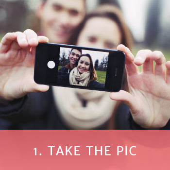 """Couple taking a selfie with a red box overlay and text reading """"Take the pic"""""""