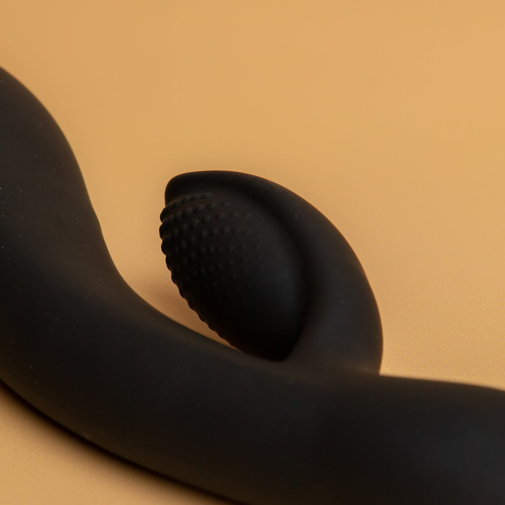 Image focused on the clitoral stimulator. The textured part is dotted for added sensation. Xesproducts.com.au xes products