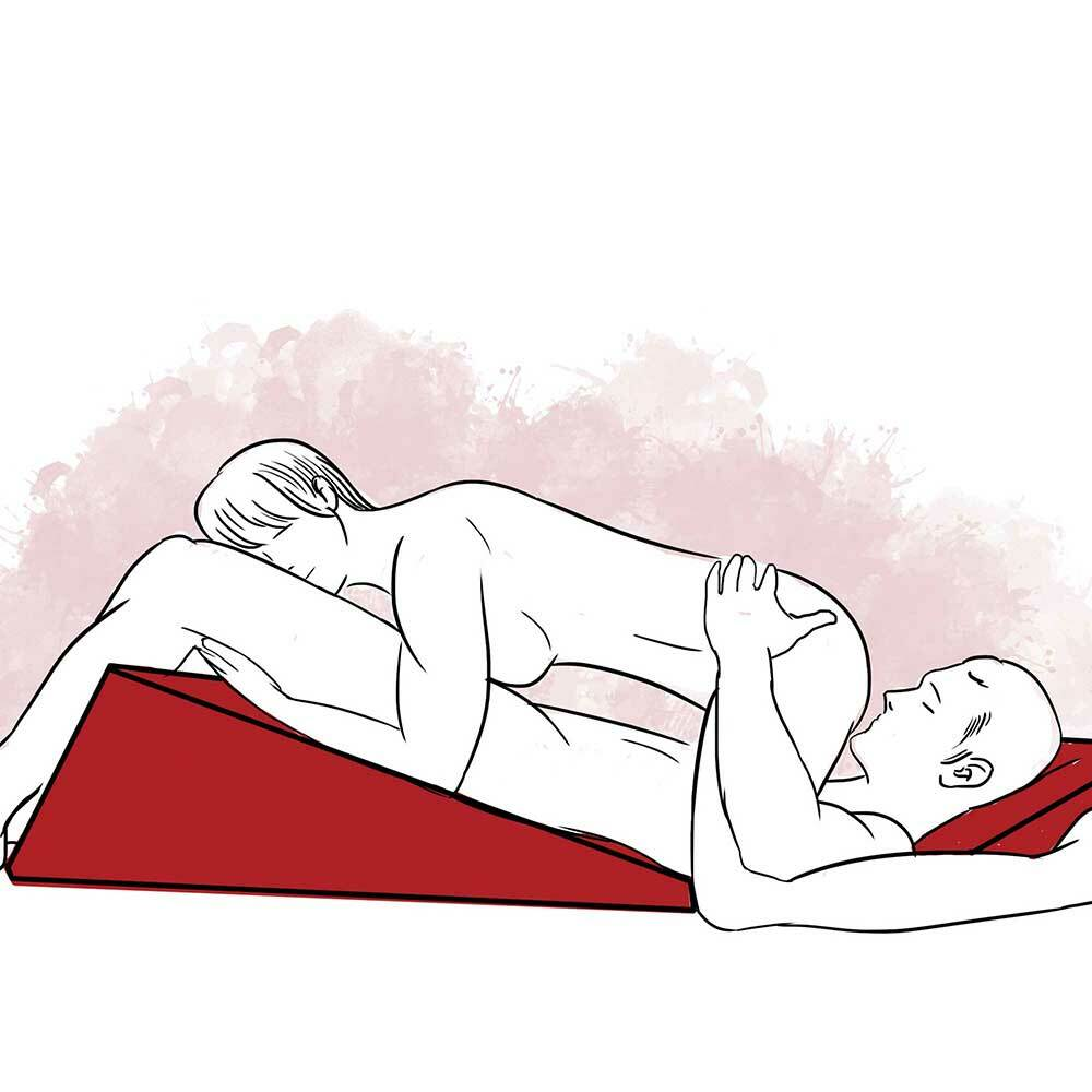 Illustration of one partner lying with his back on the ramp, while his head is propped on the wedge. The other partner is lying on top of her partner with her forearms resting on the ramp.