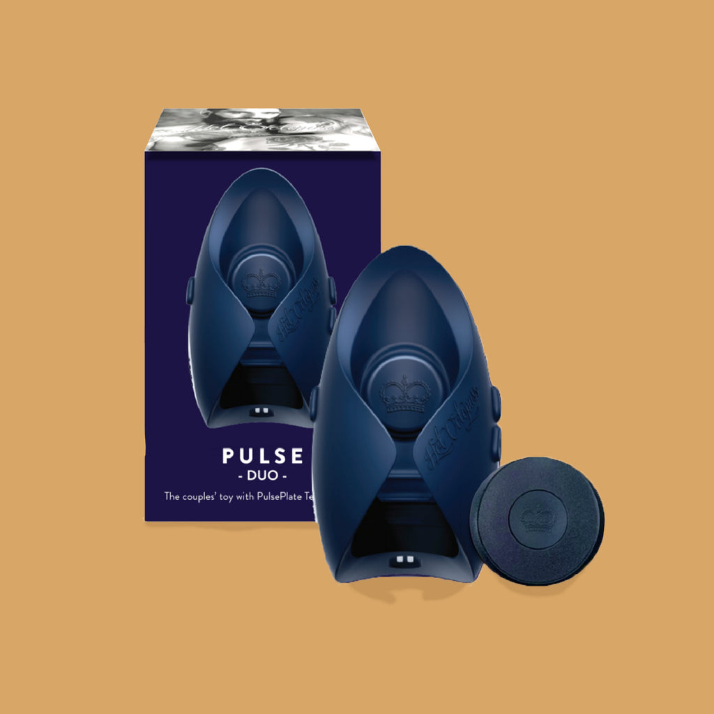 The hot octopuss pulse duo. The guybrator is black and can curve around the penis with two wings. The guybrater is slightly higher at the end. There is a plus and minus button on the side of the vibrator to change the vibration. The packaging is in the background