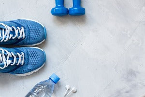 Running shoes, weights and other equipment to help get ready for a virtual half marathon in Canada