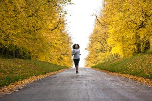 Woman racing down a path during running events in Canada
