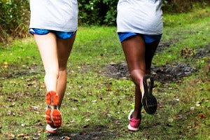 Two women running a virtual 5K in Canada in the park