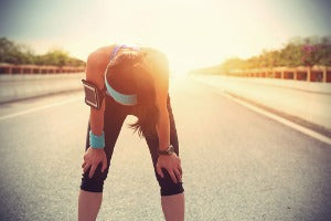 A female runner taking a break after getting too hot during a virtual run