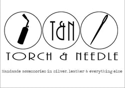 The image has a jeweller's torch and a needle to stitch with that implies these are the tools that are needed to make our products. We make sterling silver jewellery that needs a torch and genuine stitched leather that use a needle