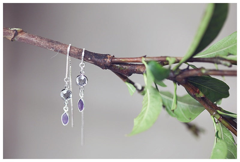 Green and purple earring threads
