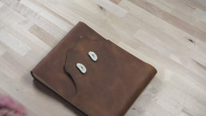 video closer look at large buffed tan leather sketchbook