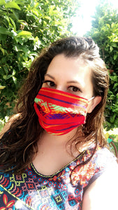 Customer wearing serape mask.