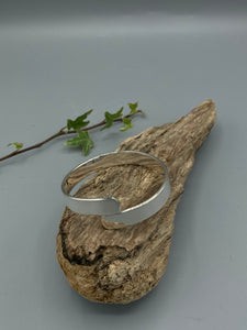Sterling Silver Bangle, flat crossover with a polished finish