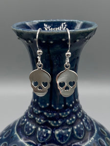 Skull polished drop earrings