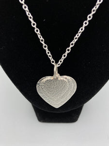 Sterling Silver Pendant. Triple heart pendant hammered finish
