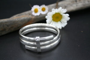 Sterling Silver Bangle polished triple band, oval 75mm x 28mm x 3.5mm bound with hammered finish clasp