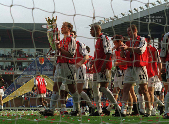 11th May 2002 Premiership - Arsenal v Everton - Dennis Bergkamp carries the trophy and leads his Arsenal colleagues on a lap of honour.  Photo by Mark Leech / Offside Sports Photography  Limited edition of 100 numbered/embossed prints.