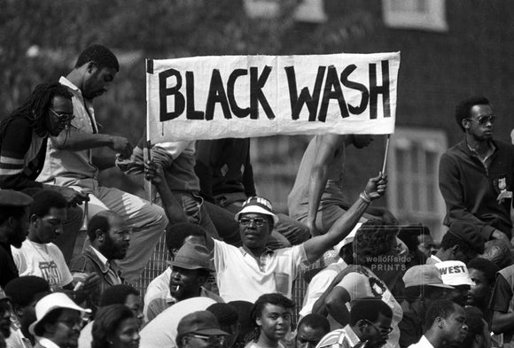 14th August 1984 - The Oval - Cricket - 5th Test England v West Indies  A West Indies fan holds up a banner with the slogan Blackwash as England lose the series 0-5.