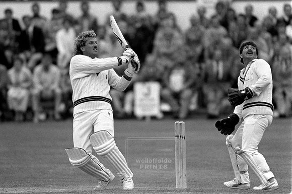 31st July 1986 - International Cricket - England v Rest of the World   Wicketkeeper Rodney Marsh watches Ian Botham cut loose.  Photo by Mark Leech / Offside Sports Photography   Archival Giclee print with a fine art pearl finish.  Limited edition of 50 numbered/embossed prints at size 22in x 16in.