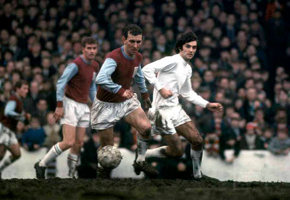 4/2/1967 English Football League Division One. Burnley v Manchester United. George Best (United) watches Brian O'Neill (Burnley) clear the ball.