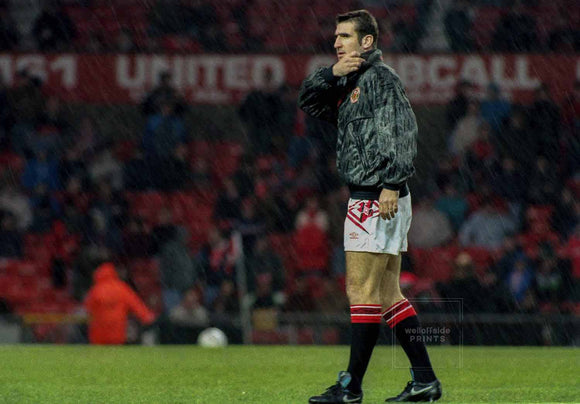 6th December 1992 - Manchester United v Manchester City  Eric Cantona in the pre-match warm-up before making his debut for United as a substitute.  Photo by Mark Leech / Offside Sports Photography (all rights reserved)  Limited edition of 50 numbered/embossed prints at size 22in x 16in.