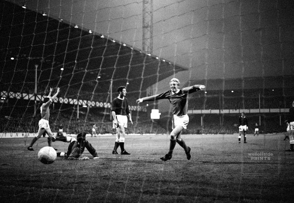 Denis Law celebrates one of the three United goals in the 3-3 draw.