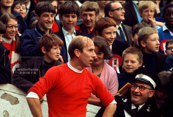 26th October 1968 - London - Football League Division One - Queens Park Rangers v Manchester United   St John Ambulance man looks in disbelief at Bobby Charlton standing right next to him as he prepared to take a corner kick.  Photo by Gerry Cranham / Offside Sports Photography  Archival Giclee print with a fine art pearl finish.