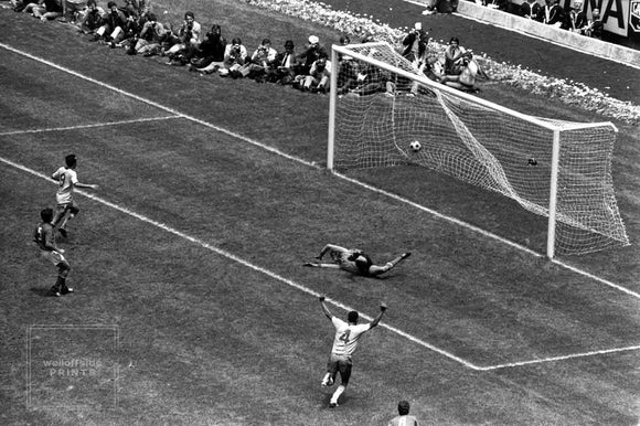 Brazil captain Carlos Alberto (4) scores past Italy goalkeeper Enrico Albertosi. If you've ever wondered why Brazil are held in such high regard in international football then just watch their fourth goal in the 1970 final scored by captain Carlos Alberto. Photographer Gerry Cranham was high up in the Azteca Stadium with the fans but caught the moment from the reverse angle of the television cameras.  Photo by Gerry Cranham (All rights reserved)  Limited edition of 25 numbered/embossed prints