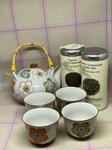White Ceramic Tea Set with Colorful Flowers