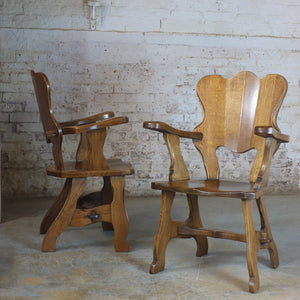 Pair of European brutalist style solid oak arm chairs