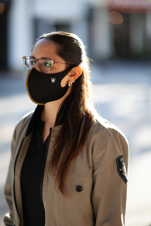 Mexican Female with Glasses and Corona Virus Face Mask