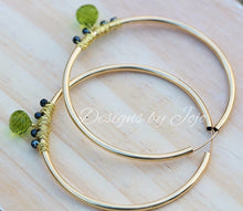 Load image into Gallery viewer, Large gold filled hoop earrings with peridot and black diamond beads.
