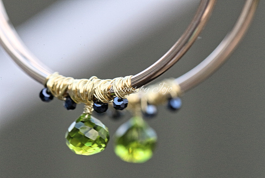 Large gold filled hoop earrings with peridot and black diamond beads.