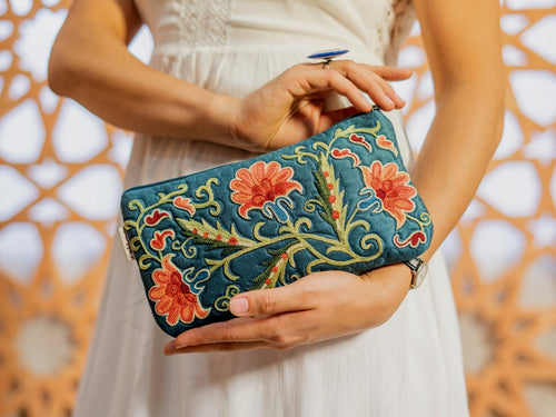 This exclusive purse is decorated with thin manual embroidery on Satin fabric (70% silk, 30 cotton) with natural-dyed silk threads.