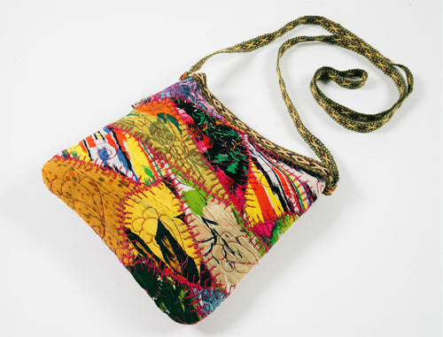 This unique purse is decorated with Kurok (patchwork) of mid-20th century on crumpled vintage silk in the front.  Back of the bag is made of old vintage Bekasam (a striped fabric made from cotton and silk).