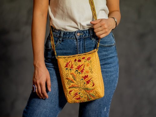 This marvelous purse is decorated with thin manual embroidery on Satin fabric (70% silk, 30 cotton) with natural-dyed silk threads & hand crafted aesthetic strap of 115 cm, trimmed with a braid.