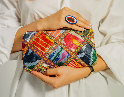 This unique purse is decorated with Kurok (patchwork) of mid-20th century on crumpled vintage silk in the front.  Back of the clutch is made of old vintage Ikat