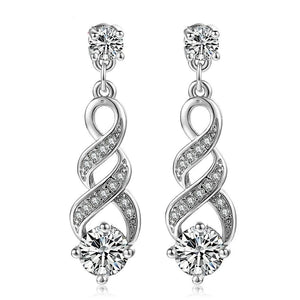 Four Claw Crystal Silver Earrings™