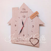 House shaped wooden wall clock