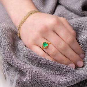 Emerald Pyramid Ring on a finger