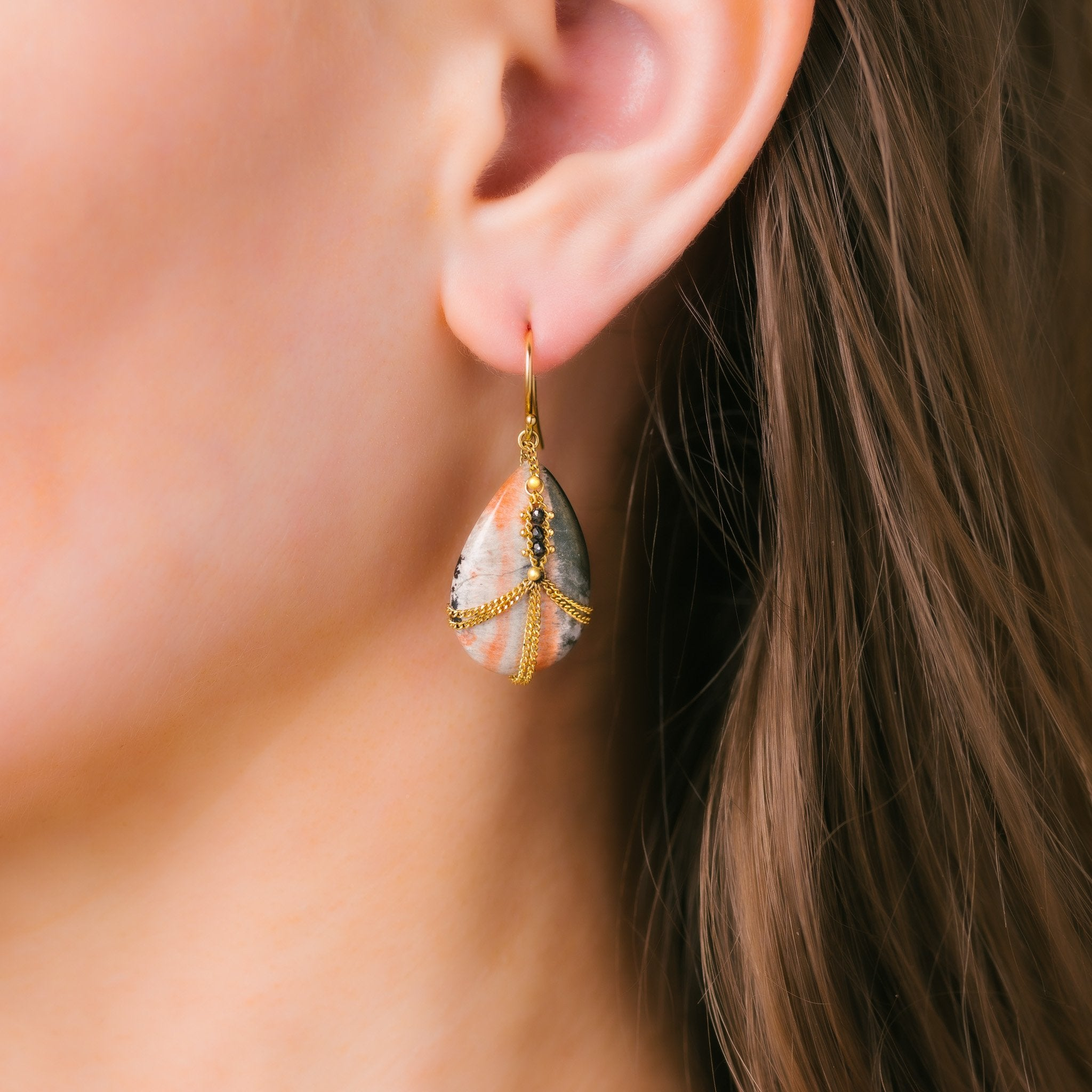 Black Diamond Draped Celestobarite Earrings on an ear