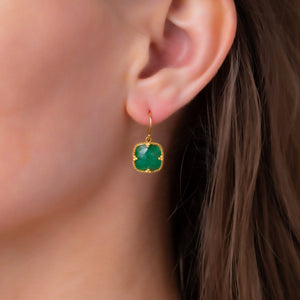 Emerald Drop Earrings on an ear