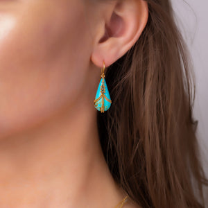 Draped Champagne Diamond & Turquoise Earrings on an ear