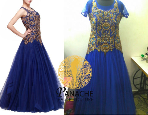 Blue color net gown with golden work