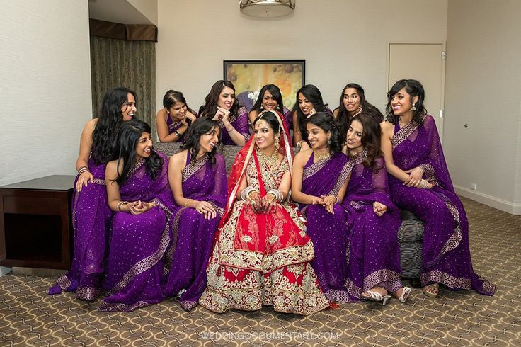 Bridemaids in purple saree