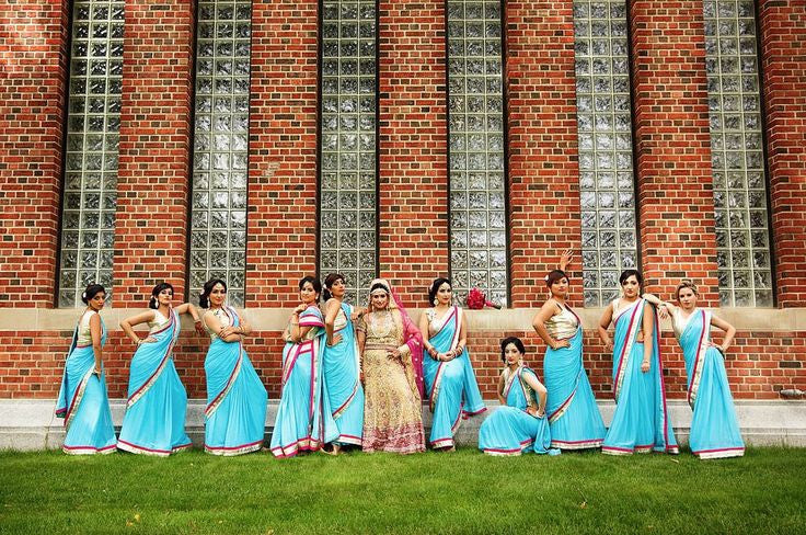 Bridemaids in sky blue sarees