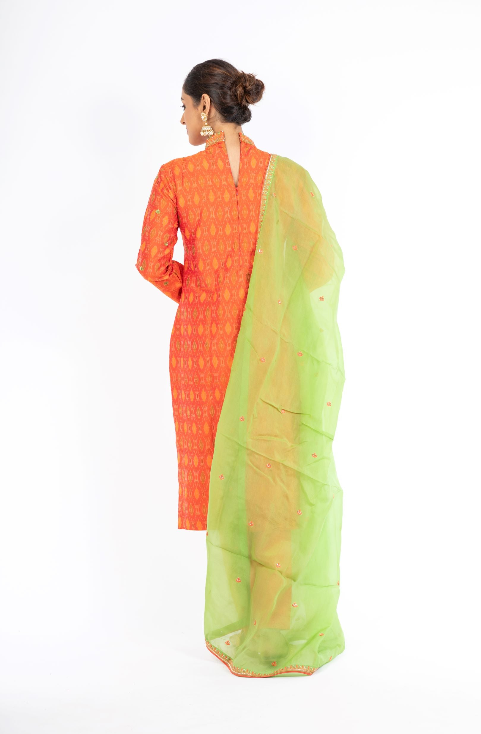 Alluring Mandarin Orange Raw Silk Ikkat Salwar Kameez