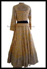 An Elegant Gold Beige Party Wear Lehenga Paired with a Silk Georgette Dupatta From Panache Haute Couture