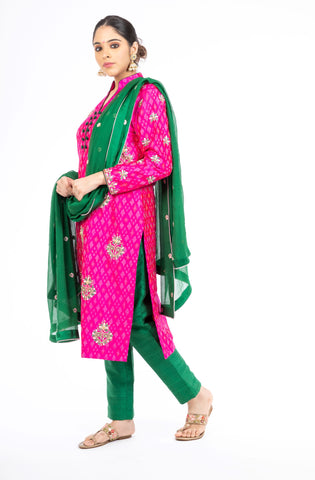 Engrossing Pink and Green Handloom Ikkat Raw Silk Salwar Kameez