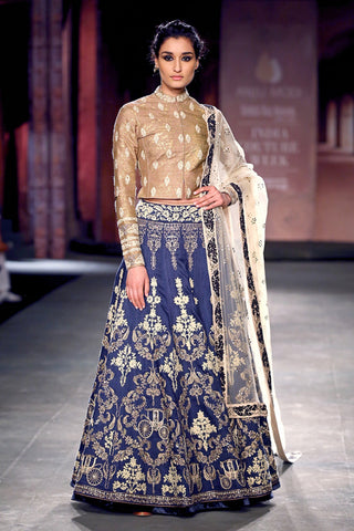Gold blouse with an embellished indigo lehenga skirt