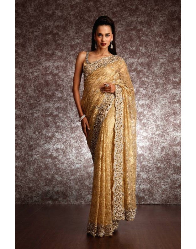 Golden color handwork net saree